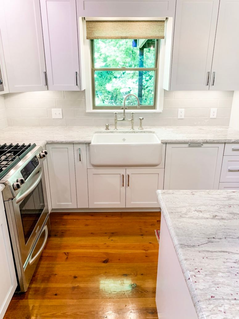 """Marazzi Middleton Square in """"Urban Mist"""" is the backsplash for this log cabin kitchen. We used Laticrete grout in """"Silver Shadow"""" to create a nice monochrome look that wouldn't distract from the marble."""